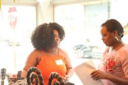 Flisadam Pointer with Empowering Her founder Asia during the Black Girl Starter Kit Interactive Workshop at Freetown Cafe in Newark NJ on 07222017 by Aziz Ramos